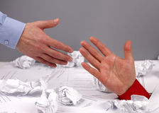 Reaching out for help. Businessman drowning in paperwork reaching for assistance and support Royalty Free Stock Photo