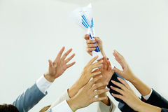 Reaching out for paper. Image of several human hands trying to get paper from male hand stock photography