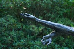 Reaching out. A sculpture with arms reaching out royalty free stock image