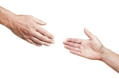 Reaching Out. Two male hands reaching out for each other isolated on white stock image
