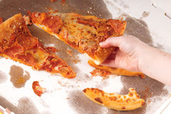 Reaching for pizza Stock Photos