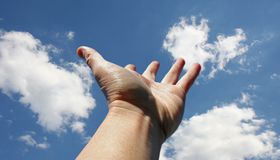 Reaching for the sky. Hand reaching for the sky Royalty Free Stock Images