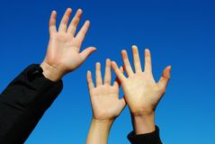 Reaching for the sky. Young hands reaching for the sky Royalty Free Stock Photography