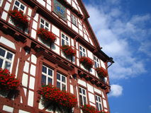 Reaching for the Sky. German buildings are created and cared for with pride. Lovingly planted flowers liven this building up Stock Photography