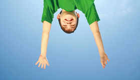 Reaching for the Sky. Teenage Boy Reaching for the Sky royalty free stock images