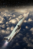 Reaching the stars. Fighter lockheed F104 climbing the sky, to reach the stars Stock Photography