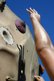 Reaching for Success!. An arm reaches for the top of a climbing wall Royalty Free Stock Images