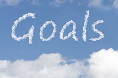 Reaching your dreams. The word goals written in the blue sky, Reaching your dreams Royalty Free Stock Photos