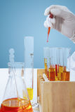 Reactants fluid mixed in research tube Royalty Free Stock Photos