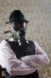 Reaction. Businessman with a gas mask having a reaction about pollution subject Royalty Free Stock Image