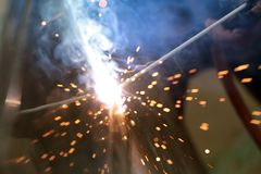 The reaction of welding wire and metal with smoke fire and spark Stock Images