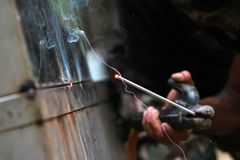 The reaction of welding wire and metal with smoke fire and spark Royalty Free Stock Image