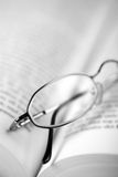Read. Close up of glasses on a book Royalty Free Stock Photo