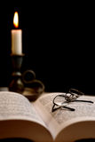 Read. A book, glasses and a candle Royalty Free Stock Images