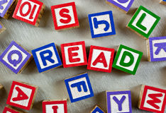 Read. Wooden blocks forming the word READ in the center Stock Photos