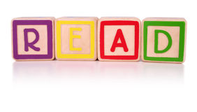 Read blocks. Children's colorful building blocks isolated, spelling the word read. Clipping path included Stock Image