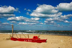 Read boat. Little row boat on a sand beach of adriatic sea stock photo