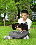 Read book. Asian young man read book Royalty Free Stock Photo