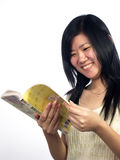 Read Book-2. Asian girl read book with white background Stock Photo