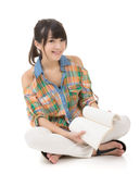 Read book. Asian young woman sit and read book, full length portrait on white Stock Photography