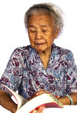 Read Book. Grandmother read a book with white background Stock Photo