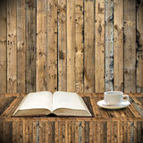 Read book with coffee in library Royalty Free Stock Photos