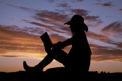 Read book silhouette sit Stock Images