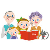 Read a book to a grandchild Stock Photography