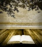 Read book on wooden table in retro style Stock Image