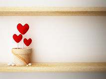 Read heart in flower pot on wood shelf Royalty Free Stock Photo
