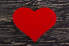 Read heart  on grunge wood background. Read heart  on grunge dark wooden background Royalty Free Stock Photography