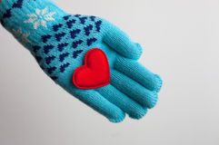 Red heart in hand in warm glove for Valentines Day. Red heart in hand in warm glove on Valentines Day Royalty Free Stock Photos