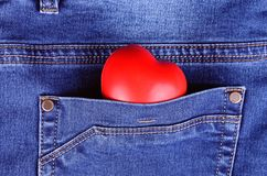 Read heart shape in blue jeans pocket Stock Photography