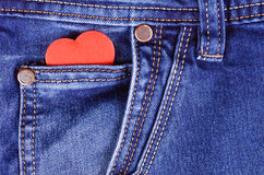 Read heart shape in blue jeans pocket Stock Images
