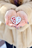 Read heart in white warm wool gloves Royalty Free Stock Photo