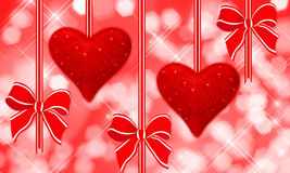 Read hearts and bows hanging Stock Photo