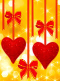 Read hearts and bows hanging royalty free stock photos