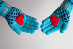Red hearts in hands in warm gloves for Valentines Day Royalty Free Stock Photography