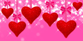 Read hearts hanging with pink bows Royalty Free Stock Image