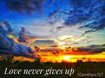 Love never gives up with sunset background. Read inspirational Bible verses and quotes that will encourage and uplift you royalty free stock images