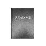Read me. Manual book with blcak cover isolated Royalty Free Stock Photo