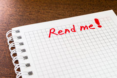 Read me sign in the notebook Stock Photos