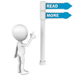 Read more. Words on a road sign being pointed out by a small man, concept of reading books Stock Photography