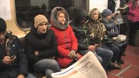Read a newspaper in the subway stock video