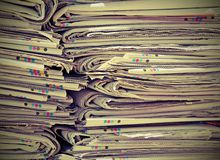 Read newspapers ready for the paper production processors used Stock Images