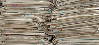 Read newspapers ready for the paper production processors used Royalty Free Stock Image