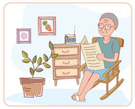 Read old newspaper. Elderly people at home and read the newspaper too Royalty Free Stock Photos