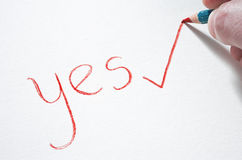 A read pastel pencil writing the word YES Royalty Free Stock Photos