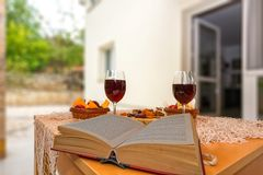 Read and relax. Book, wine and dried fruit. Enjoying life Stock Photos