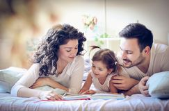 Read stories your children. Family time royalty free stock images